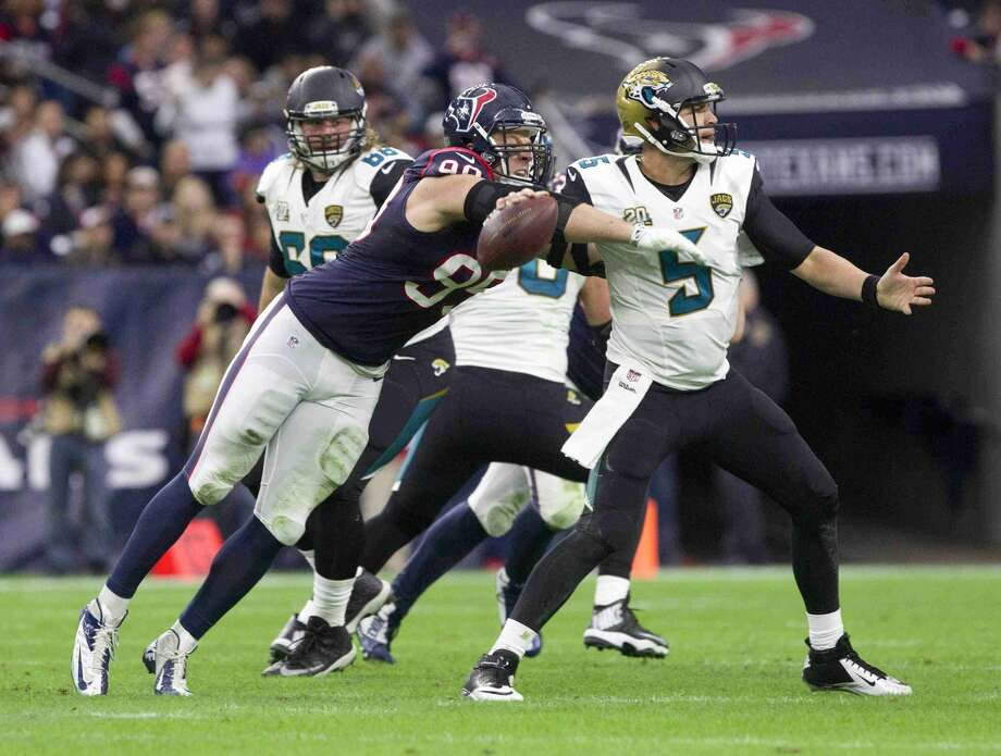 Houston Texans defensive end J.J. Watt (99) hits Jacksonville Jaguars quarterback Blake Bortles for a strip-sack in the first half of an NFL football game Sunday. Photo: Jason Fochtman
