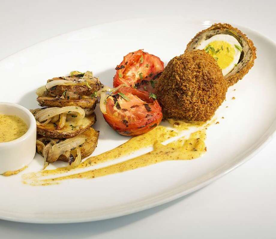 The Scotch Egg, a hard boiled egg wrapped in sage sausage and topped with a Cajun hollandaise sauce, at B&B Butchers and Restaurant. Photo: Courtesy Photo