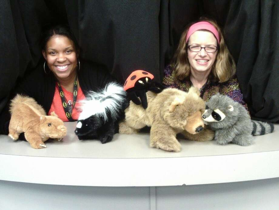 "Aarica McIntyre (left) and Laurie Jeffers (right) brought a cast of furry characters to live in the puppet show ""Wake Up, Bear."" The activity is one of many during Story Time for children ages three to six at the Sugar Land Library."