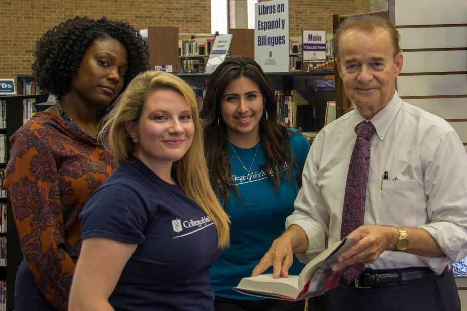 Dr. A. Rodney Allbright, right, interim president of College of the Mainland, talks with students in the COM Library.