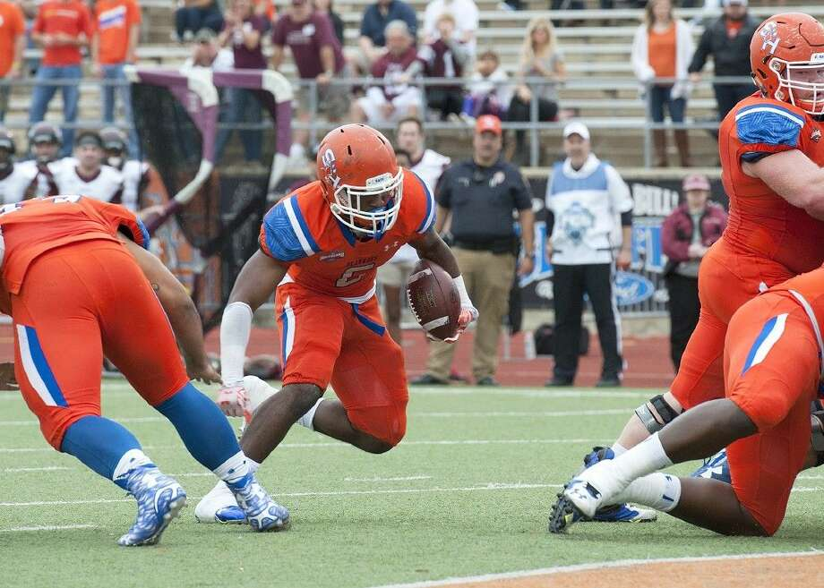 Sophomore running back Corey Avery finds a hole in a quarterfinal game against Colgate.