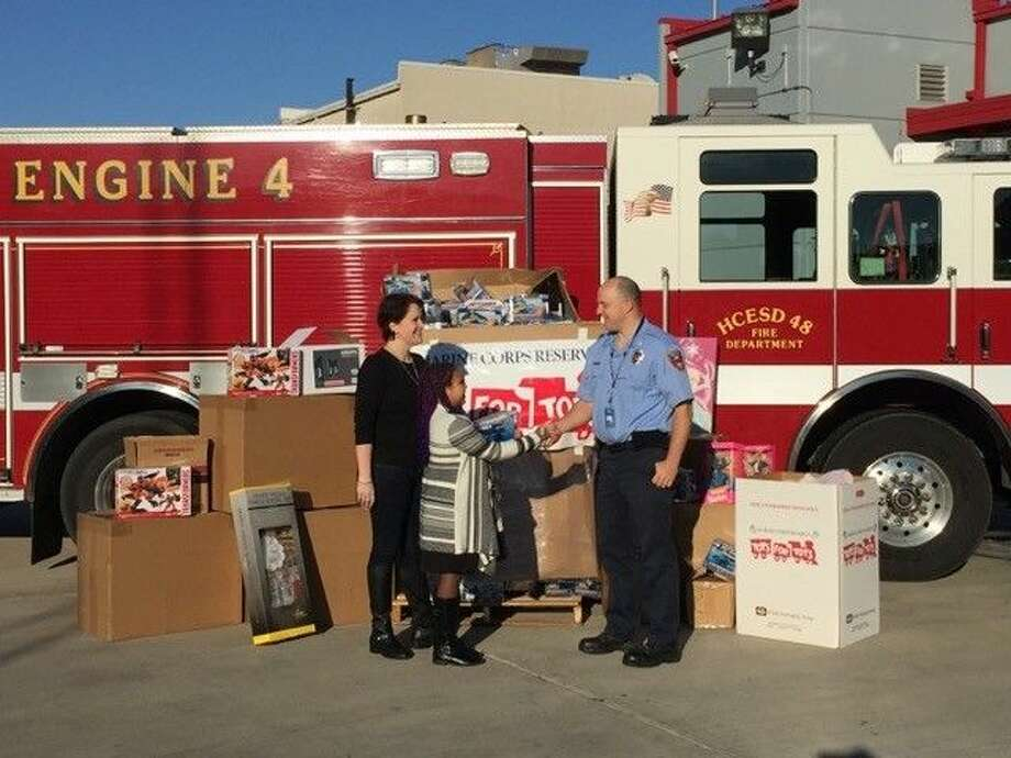 HCESD 48 PIO Simon Van Dyk thanks Katy resident Tracy Varendon and her daughter for their generous donations to the 2015 Toys for Tots drive. Though the two are moving to California, their impact won't soon be forgotten by more than 900 kids this Christmas.