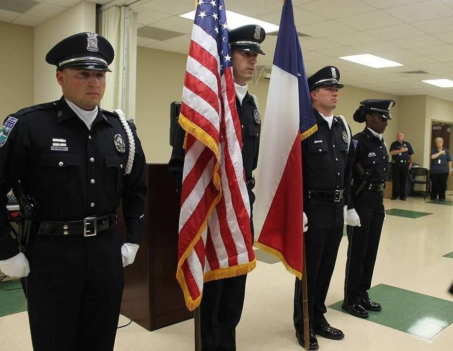 Members of the Honor Guard present the colors at a PCPAAA graduation ceremony.