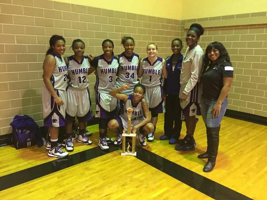 The Lady Wildcats pose with the first place trophy from winning the 2014 Sam Houston Holiday Classic after beating Kashmere 44-39 in the final.