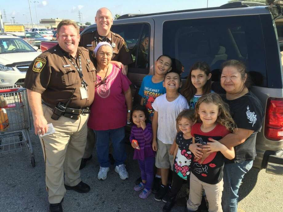 Fort Bend County Sheriff's Office Deputies Chris Carlson and David Craven are shown with the Mary and SanJuanita Ortega family.