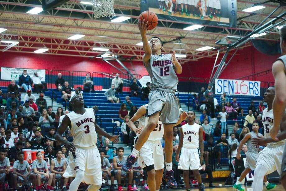 Dawson's Jules Moor (12) makes a move to the basket in overtime against Manvel Tuesday night. Photo: KIRK SIDES