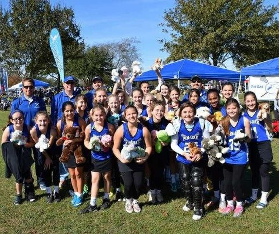 The Pin Oak Middle School girls lacrosse team recently participated in the Cy-Fair Burning Flower Tournament in Hockley and besides playing their games, they helped collect stuffed animals.