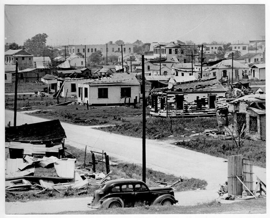 The Texas City Disaster of 1947 caused major damage to homes and businesses. In this photo, part of the Moore Memorial Public Library Collection at the Portal to Texas History, houses are shown with heavy roof and wall damage. One of the houses in the foreground is collapsed. Photo: Portal To Texas History