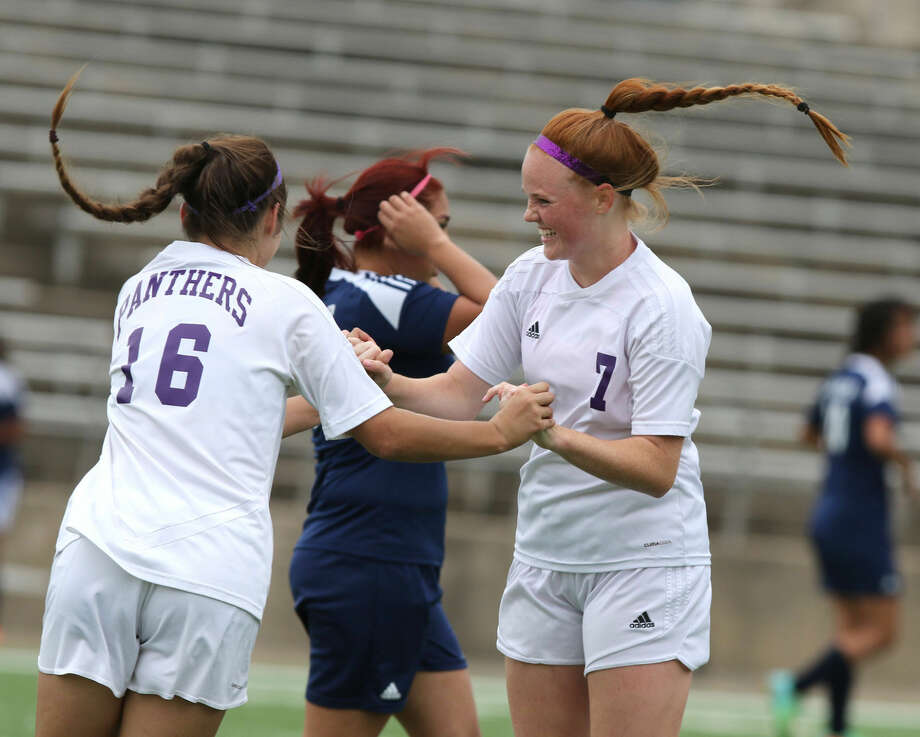 Ridge Point's Madison Ellis (7) celebrates her goal with Hannah Dupin (16) during a 2015 playoff game. The Lady Panthers repeated as District 23-5A champion and reached the regional quarterfinals. Photo: HCN File Photo