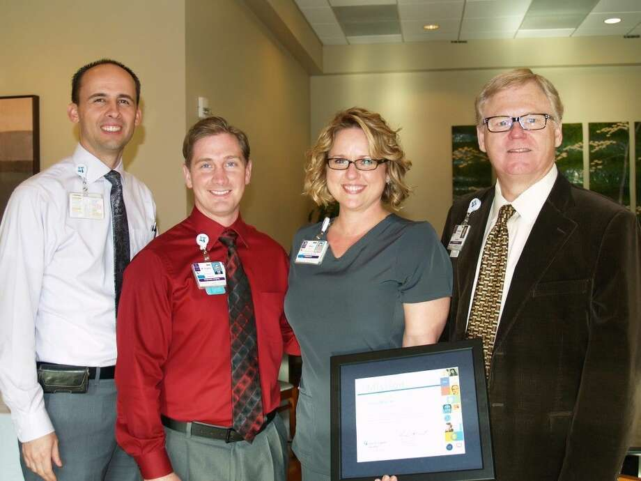 From left are Ryan Tingey, Director of Operations, Austen Holton, Director of Diagnostic Imaging, Sheri Mauck, award recipient, and Norman Stephens, President. Photo: Submitted Photo