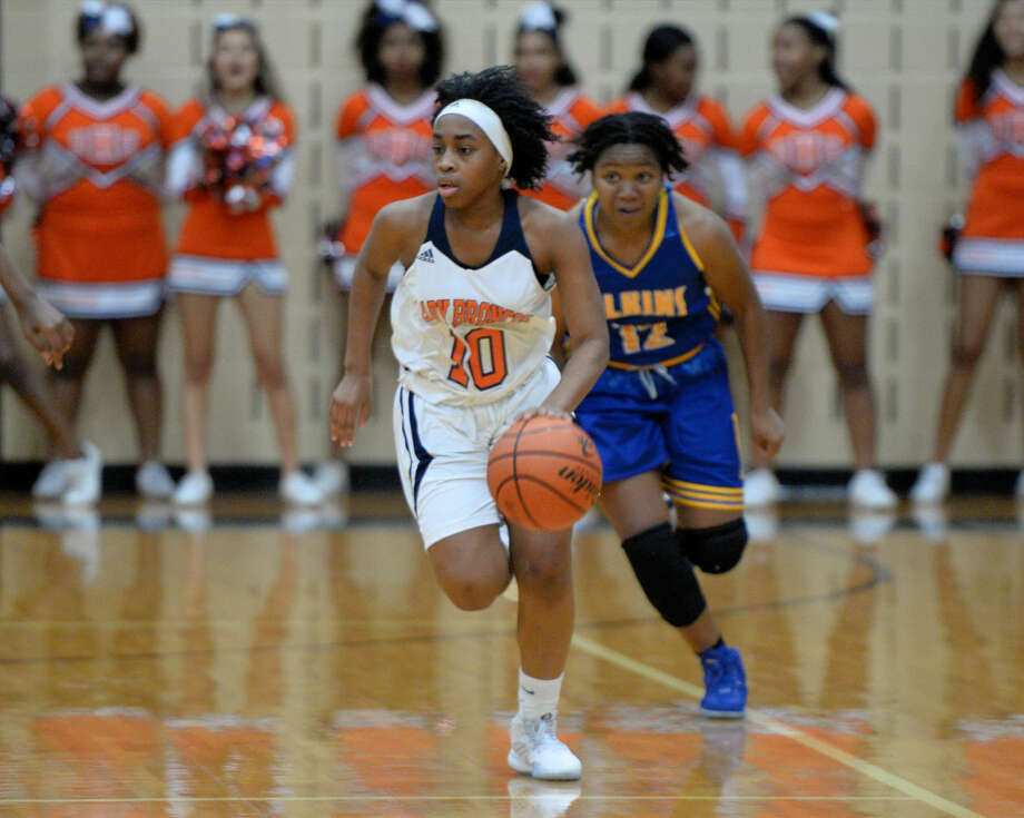 Iman Lloyd and the Bush girls basketball team won their third district championship in four years and added a playoff victory to finish 23-8. Photo: Craig Moseley
