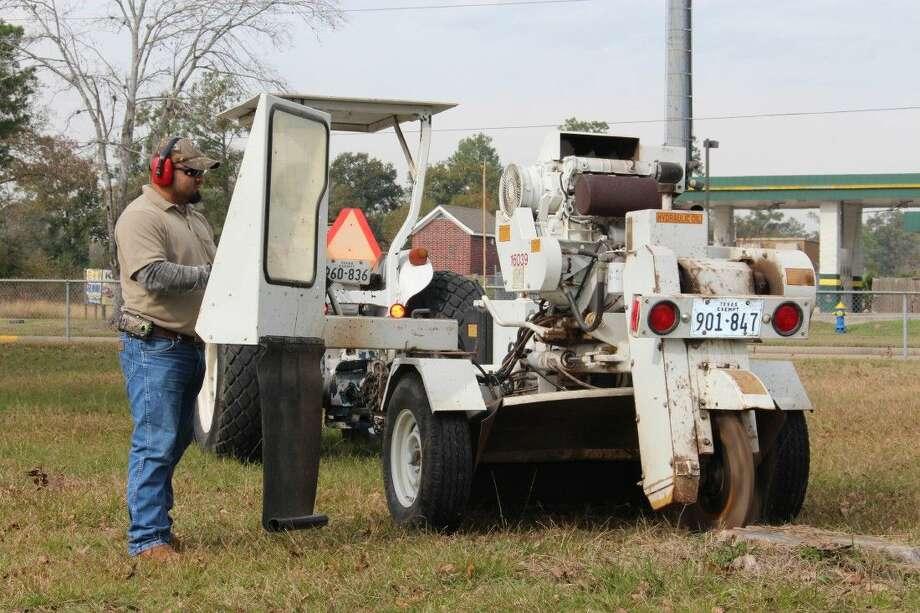Edgar Nataren maneuvers a stump grinder machine at Meyer Park. Photo: Submitted Photo
