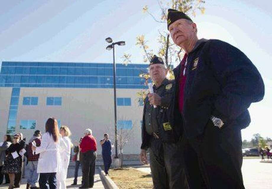 Larry Eary and Roy Faucette talk before the grand opening of the new Conroe VA Outpatient Clinic on Dec. 4. The new clinic location spans more than 30,000 square feet with many additional services for veterans.