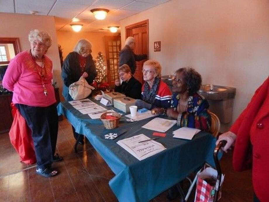 Beverly Wooley, Judy McFarland and Callie Crooks distribute information about Big Stone Lodge programs during the Mistletoe Magic Luncheon. Photo: Submitted Photo