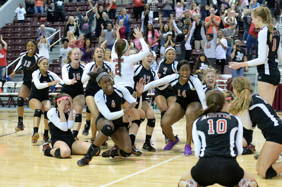 The Austin volleyball team celebrates its Region III-6A championship Nov. 14 at the Campbell Center in Houston. The Lady Bulldogs reached the first state volleyball tournament in FBISD history. To view or purchase this photo and others like it, visit HCNpics.com. Photo: Craig Moseley