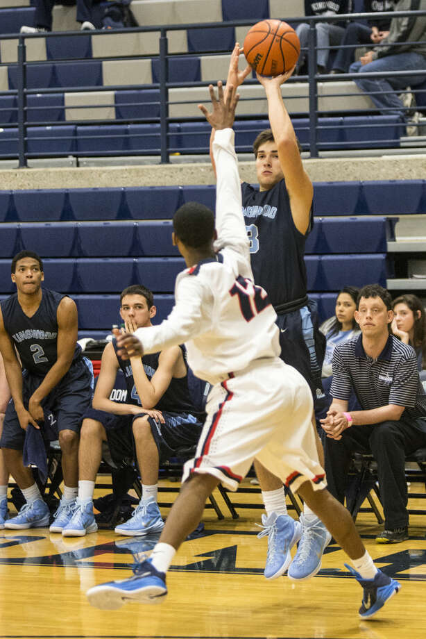 Kingwood's Bryan Butler (3) hits a three point shot during Kingwood's 67-62 loss to Houston Lamar during the first round of The Insperity Holiday Classic on Dec. 29, 2014, at Kingwood High School. Photo: Andrew Buckley