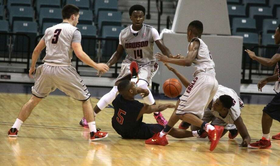 Dawson, shown here playing Cy-Springs in the 2014 Boy's Basketball Katy Classic Silver Bracket Championship, plays Manvel this Saturday in a District 22-6A basketball game. Photo: Staff Photo By Alan Warren