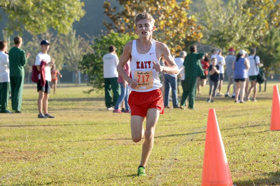Ryan Yerrow and Katy ran to the first District 19-6A championship in school history, Oct. 16 at Bear Creek Park. The Tigers added a regional title before placing fifth at state. Visit HCNPics.com for more photos. Photo: Craig Moseley