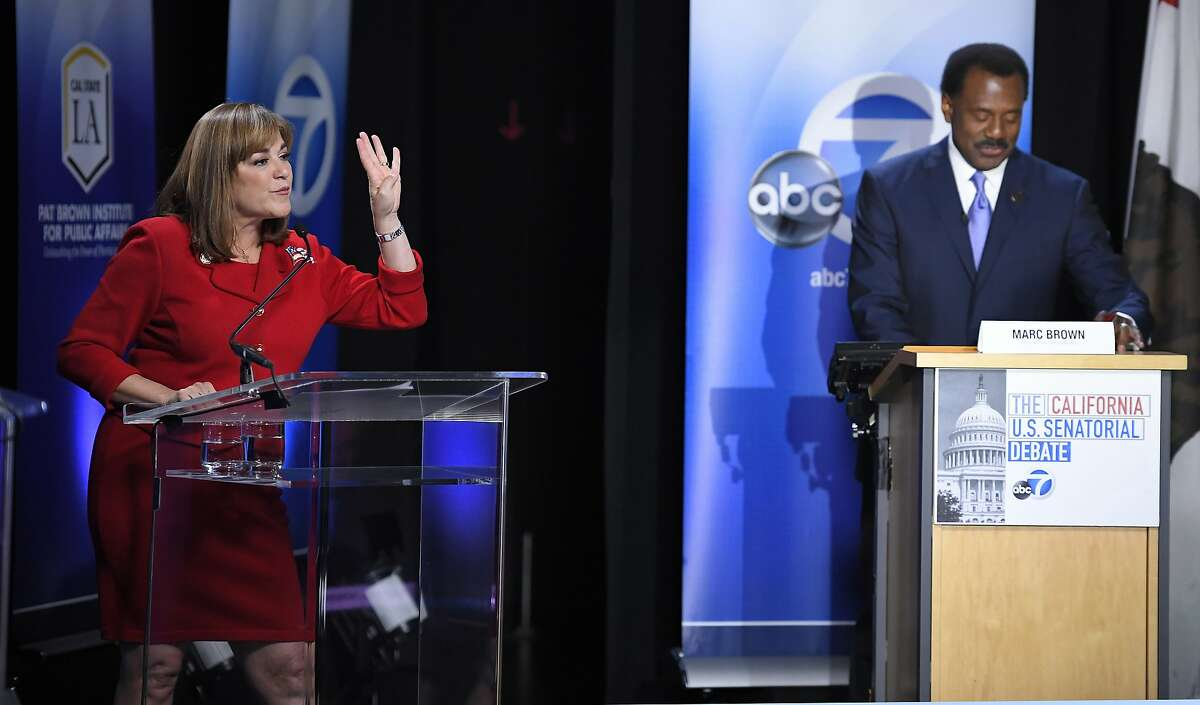 California U.S. Senate Democratic candidate Congresswoman Loretta Sanchez, left, continues to speak as moderator Marc Brown tells her that her time is up during a debate against California Attorney General Kamala Harris, Wednesday, Oct. 5, 2016, in Los Angeles. (AP Photo/Mark J. Terrill)