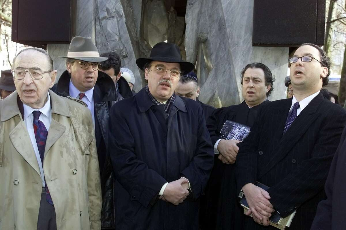 Members of the North American Boards of Rabbis sing in front of the memorial for deported jews during the NAZI-Regime in Berlin Wednesday March 14, 2001. The interdenominational North American Board of Rabbis visited Berlin for three days to focus on improving German-Jewish-American relations and on bringing the example of interdenominational Judaism to Germany's burgeoning Jewish population. From left to right: Rabbi Ted Alexander, Executive Vice President Rabbi Jay Rosenbaum, chairman of Berlin's jewish community Andreas Nachama, the Cantor of Berlin's Community Isaac Sheffer and President of the board Rabbi Marc Schneier. (AP Photo/Roberto Pfeil)