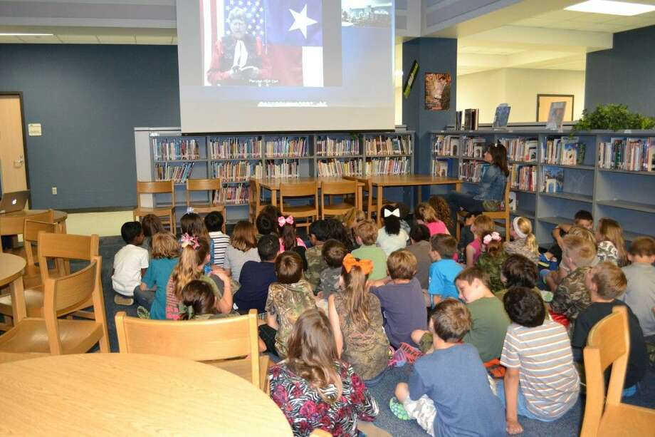 Windsong students watch authors.