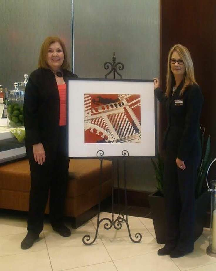 Pictured, left to right, are Sally Stubbs, artist and Dee Northcutt, General Manager, Hilton Garden Inn Pearland.