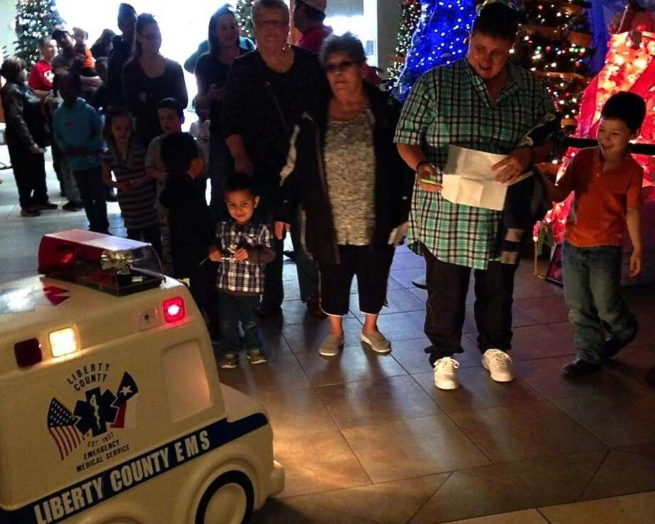 Children are greeted by Liberty County EMS at the Dayton Community Center on Saturday, Dec. 19, when they came to pick up their gifts from Liberty County Bikes for Christmas. Photo: Submitted Image
