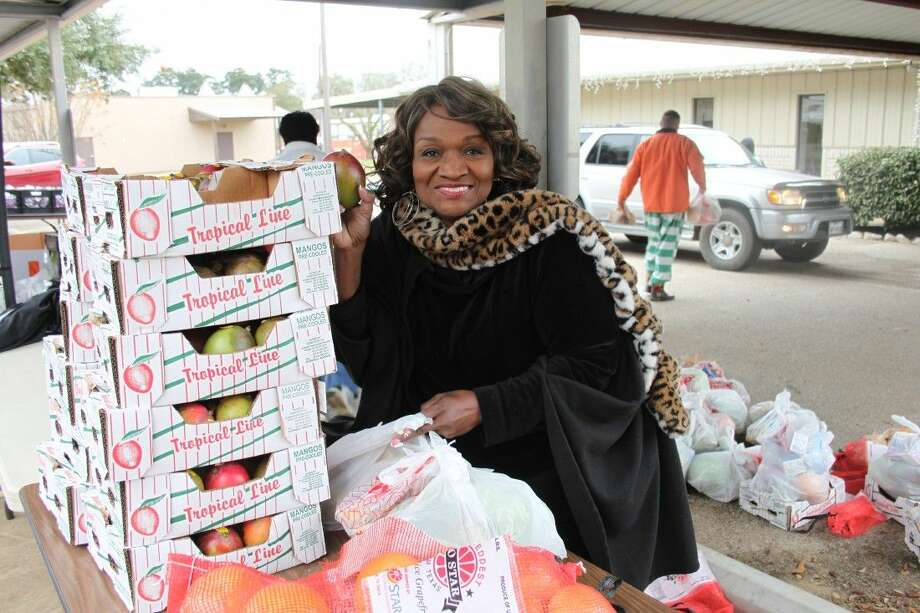 Carolyn Jefferson helps prepare bags of food to be given away to families in need in San Jacinto County. The food giveaway, held on Dec. 30, was arranged through the Houston Food Bank and the Coldspring Senior Citizens Center.
