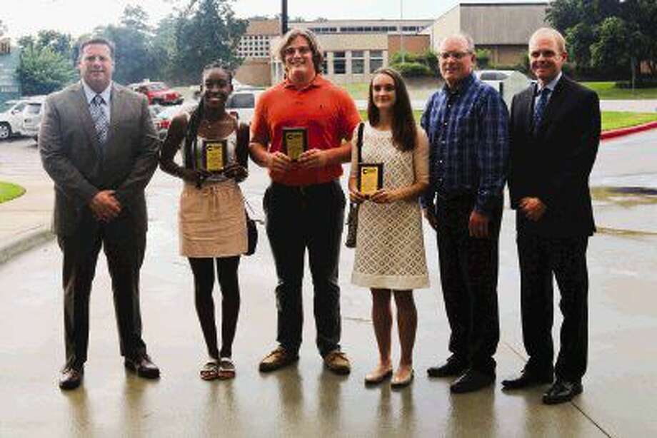 The Woodlands High School students who competed and won in their events at the 2016 UIL 6A State Championship in May in Austin were recognized by the Conroe Independent School District Board of Trustees during the June meeting. Pictured from left are coach Gary Madore, senior Teesa Mpagi, junior Adrian Piperi, senior Ellyana Long, coach Noel Hansen and head coach Juris Green.