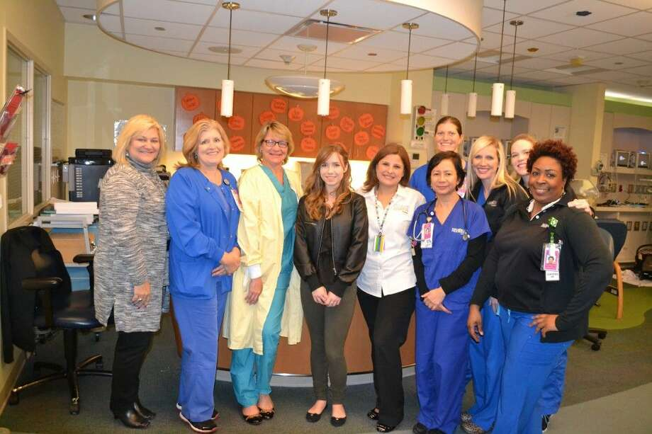 Dobie High School student presents BEAD Program the Neonatal Intensive Care Unit (NICU) at Memorial Hermann Southeast HospitalPictured (Front, Left to Right): Debra Gleisberg, Perinatal Educator, Staci Miller, RN, NICU Clinical Coordinator, Dr. Kathleen McDonald, Neonatologist, Sydney Sweet, Girl Scout, Julie McCarthy, Child Life Specialist, Annabelle Bonifacio Encarnacion, RN, NICU, Katina Landry, RN, Labor and Delivery Clinical Coordinator (Back, Left to Right) Ashlye Bates, RN, NICU, Natalie Forte, RN, NICU, Heather Kerneckel, Women's and Children's Services Educator.