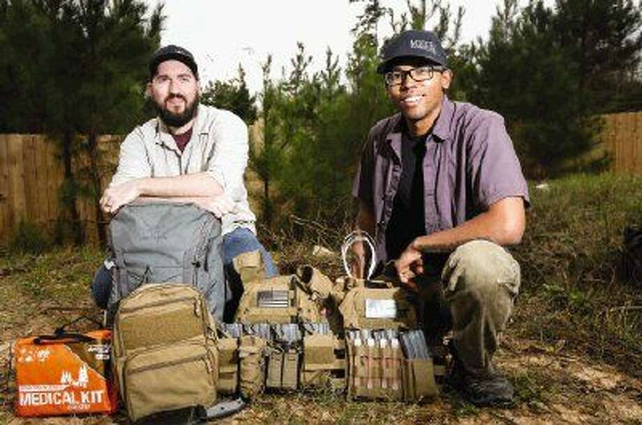 Jeff Conlon and Jazz Howard, owners of Modern Skirmisher, display some of their featured survival and outdoors gear.
