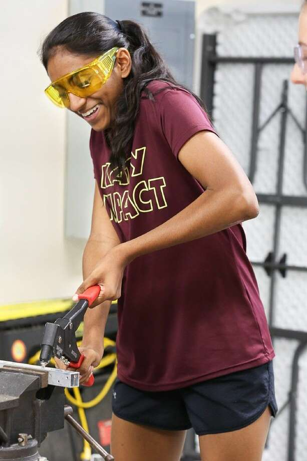 A Robotics club member works on her project in preparation for competition. Teams will have six weeks to design their robots once receiving their challenge on Jan. 9. Photo: FRC Team 624 - Lh