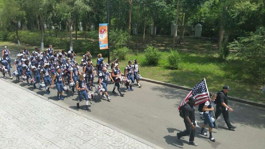 USA Football shows off its national pride during the IFAF U19 World Cup last week in Harbin, China. The team featured two athletes from Cy-Fair ISD, Paul Watson (Langham Creek) and Brandon DePrato (Cypress Woods). Photo: C/o USA Football