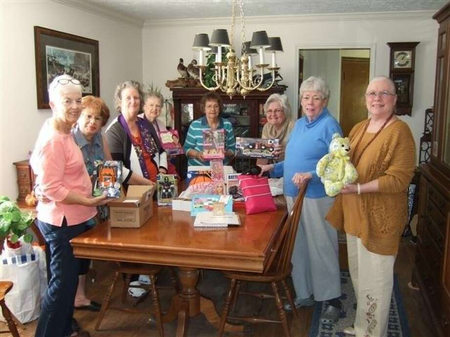Pictured with toys are Jean Kern of Friendswood; Julie Hoover of Houston; President Diana Embrey of Friendswood; Marlene Broome of Friendswood; Hostess Norma Mc Phail of Houston; Linda Abbott of Friendswood; Dian Thomasson of Alvin and Diane Gordy of Houston.