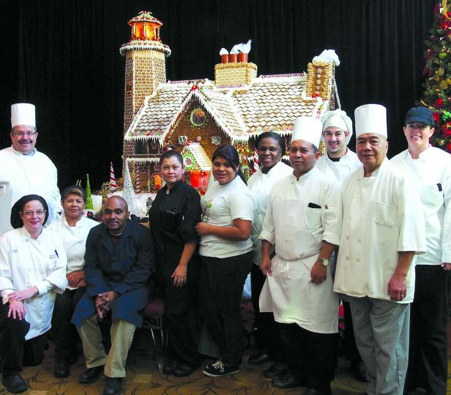 Members of the South Shore Harbour Resort Culinary Team who constructed the giant Gingerbread House for 2014 included Chef Roland Kyburz, from left, Melanie Bolen, Dinora Rivas, Perry Louis, Chappa Saira, Estefany Rivas, Alice Mitchell, Jose Mendoza, Anthony Taye and Karen Hays.