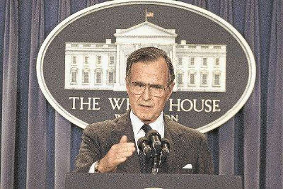 President George H.W. Bush briefs reporters May 11, 1989, at the White House.