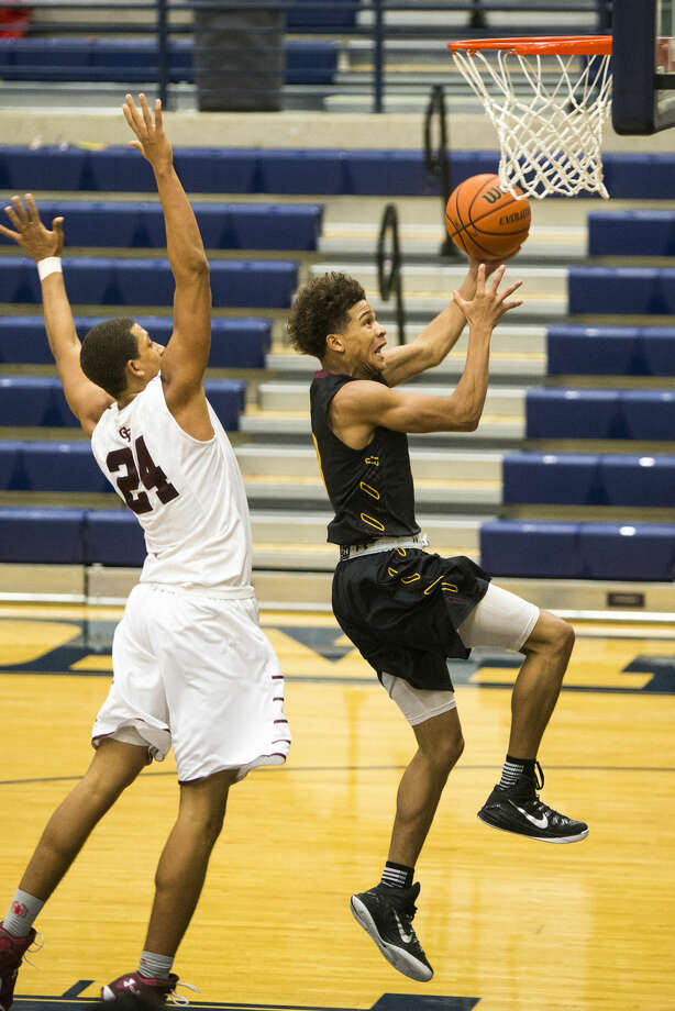 Summer Creek's Theo Baker (3) shoots a layup during Summer Creeks' 62-55 victory over Cy-Fair in The Insperity Holiday Classic on Dec. 30, 2014, at Kingwood High School. Photo: Andrew Buckley