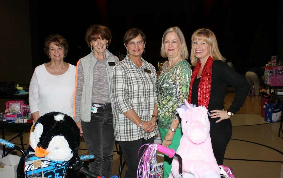 The Loft at the Woodlands United Methodist Church generously provided space for children's gift and supplies donations for the Montgomery County Women's Center (MCWC) annual Share A Family and Shelter Santa Christmas project. Pictured from left are: Marion Fischer, MCWC Board Vice Chair; Debbie Stanford, MCWC Board; JoAnne Lowry and Mary Johnson, MCWC Holiday Project Coordinators, Share a Family; and Sarah Raleigh, MCWC President & CEO.