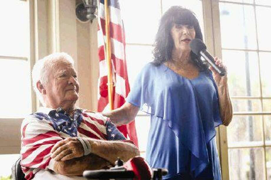 Dawn Cleboski, General Manager of the Bentwater Property Owners Association, speaks with Bob Meaders, of Operation Helmet, during the first responders tribute on Tuesday at the Bentwater Yacht Club. Photo: Michael Minasi
