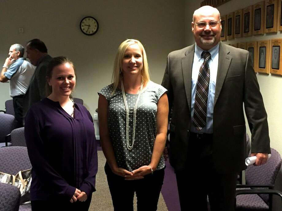 The Dayton ISD Board of Trustees met several of the district's new hires Tuesday night, July 19. At left are instructional math coaches Lauren Hobbs and Jana Richmond, and with them is Dayton High School's new Assistant Principal Tom Swacker, whose appointment was approved by the board late Tuesday night. Photo: Casey Stinnett