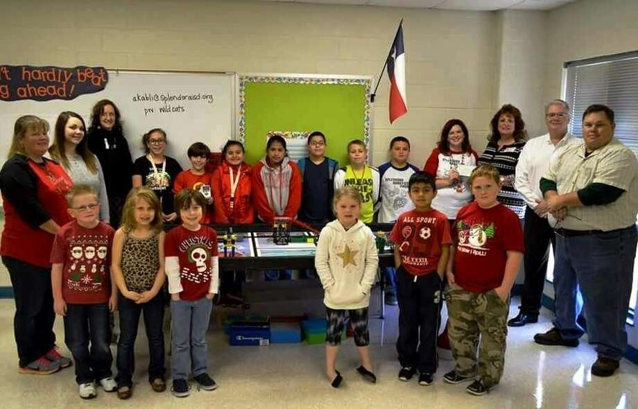 The Splendora ISD elementary robotics program is expanding, with help from the EMCID Board of Directors, who presented Instructor Alex Kabli with a check for $6,982.82 to help fund the program expansion. Photo: Submitted