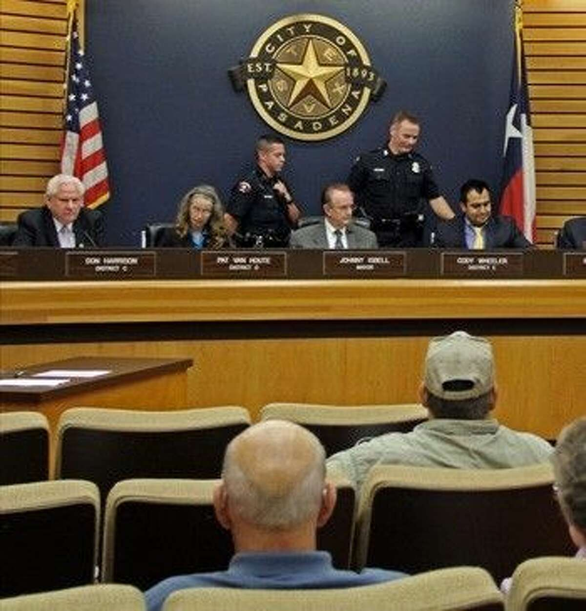 Citizen watch as Mayor Johnny Isbell instructs police officers to remove Councilmember Cody Wheeler from a council meeting for not following rules that limit comments to two minutes.