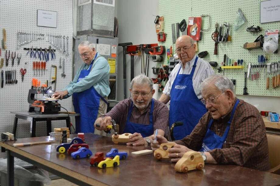 Members of the Parkway Place Men's Activity Club hard at work hand-making toys that will be donated to local children in need.