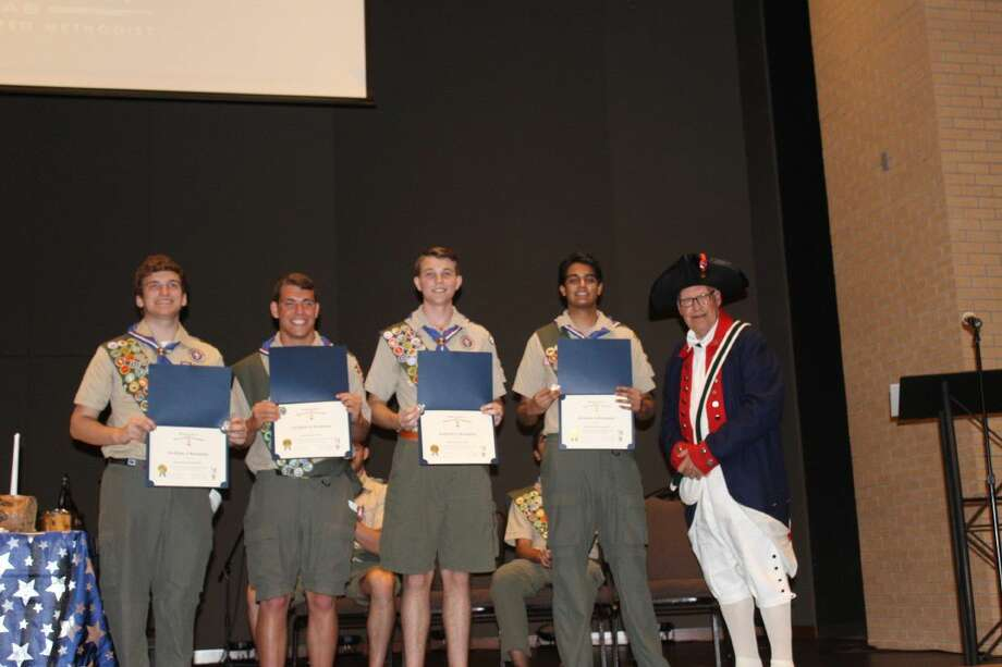 Eagle scouts (left to right): Michael Scofield, Blake Cotter, Dakota West and Arun Dasmophatra being presented with certificates and coins from the Sons of the American Revolution (SAR) by Bill Whatley.