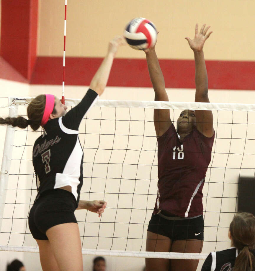 Cinco Ranch's Makayla Randle blocks Pearland's Brooke Botkin during the Spring Branch ISD 2014 Varsity Tournament, Aug. 21 at Memorial High School in Houston.