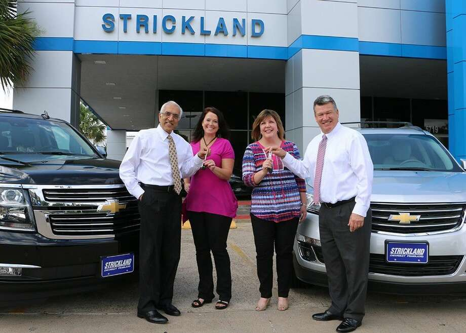 Strickland Chevrolet recently gave Pearland ISD Teachers of the Year the keys to two program vehicles for one month of summer cruising. Pictured are (from left) general manager Lee Mehta, Ann Lowrey Merrill, Kristine Holland and general sales manager Todd Harvey.