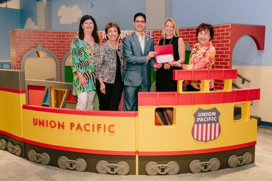Union Pacific Railroad Director-Public Affairs Richard Zientek presents a check for a new exhibit in the Fort Bend Children's Discovery Center. Joining Zientek are, from left, Capital Campaign Co-Chair Debbie Fash, Children's Museum of Houston Executive Director Tammie Kahn, and Capital Campaign Co-Chairs Rachel Leaman and Charlene Pate. Photo: Submitted Photo
