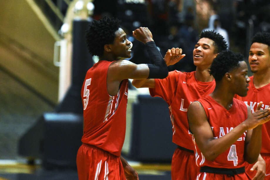 Cypress Lakes senior guard De'Aaron Fox celebrates with his teammates after the 75-72 playoff win against Bellaire Friday, February 26, 2016, at the Don Coleman Coliseum. Fox graduated in May, leaving Cy Lakes and Olatunbosun looking to replace his 31.3 points per game.
