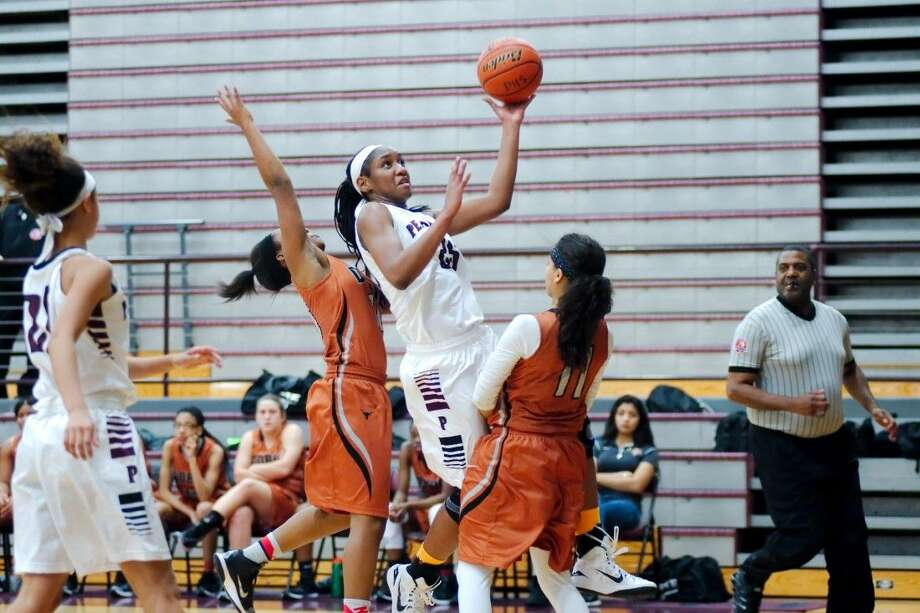 Pearland's Jasmine Butler (25) puts up a shot over Dobie's Jade Giron (11) Tuesday in a District 22-6A girls' basketball game. Butler scored 19 points in Pearland's 38-36 win. Photo: KIRK SIDES