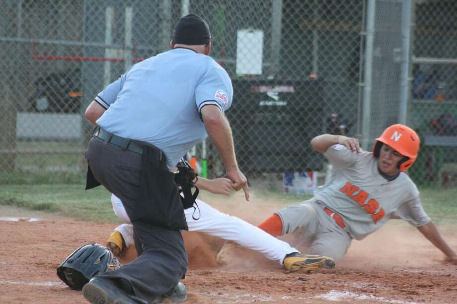 A NASA-Orange runner slides in with another key run during their sixth-inning uprising. Photo: Robert Avery